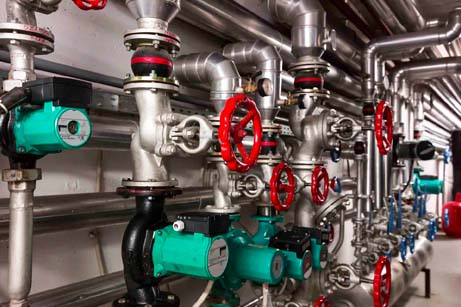 Picture of a closed loop water system with red valves.