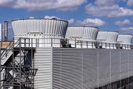 Cooling towers from a cooling water system on top of a building