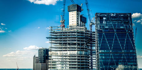 New construction of a tall building with cranes
